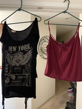 Black shirt with fringes on the side and a red crop top in Travis AFB, California