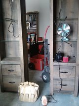 2 Tall cabinets with middle connectors $75, tool bag $15 in 29 Palms, California
