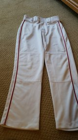 Youth medium red piped baseball pants in Houston, Texas