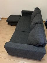 dark gray couch and ottoman in Okinawa, Japan