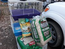 Small animal cages  big  bag of litter and food in Fort Leonard Wood, Missouri