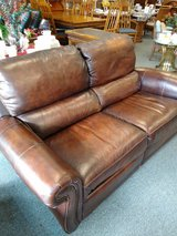 Brown Leather Reclining Loveseat in Naperville, Illinois