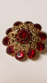Vintage red brooch in Byron, Georgia