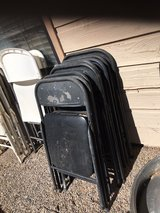 13 black foldable chairs in Alamogordo, New Mexico