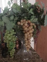 Glass vase with vine and grapes in Spring, Texas
