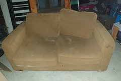 Fold out brown couch in Ramstein, Germany