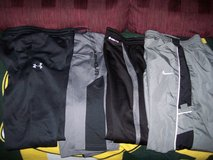 4 Pairs Boy's size large athletic pants Nike, tek gear  under armour in Chicago, Illinois