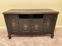 Black TV Console with floral design in Chicago, Illinois