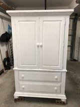 White shabby shic dresser/media cabinet/armoire in Camp Lejeune, North Carolina