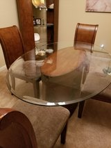 Glass top table with 4 chairs and Curio $350.00 in The Woodlands, Texas