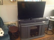 TV and stand in Batavia, Illinois