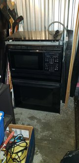 Kenmore black in wall microwave/oven unit in Naperville, Illinois