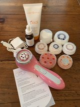Clarisonic Smart Profile Cleansing Brush with various head attachments in Kingwood, Texas