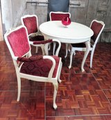 White Chippendale Table with Red Chairs in Ramstein, Germany