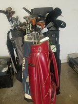 4 Golf bags with clubs in Oswego, Illinois
