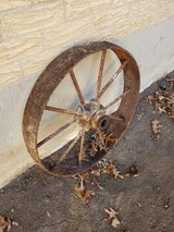 Small Rusty Metal Wagon Wheel in Chicago, Illinois