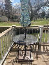 Outdoor small patio set with stand and umbrella in Chicago, Illinois