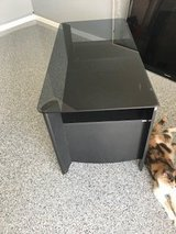 Smoke glass & black entertainment/tv stand in The Woodlands, Texas