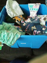 Bin of girls clothes 5,6,7 now reduced to 25 cents each outside in Chicago, Illinois