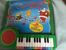 Play me Christmas. Song book and piano in Westmont, Illinois