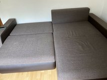Large L shape couch with bed function and storage in Ramstein, Germany