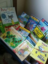 Bin of kids books for 25 cents each outside in Yorkville, Illinois
