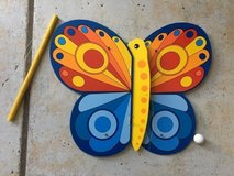 Colorful hanging wooden butterfly in Stuttgart, GE