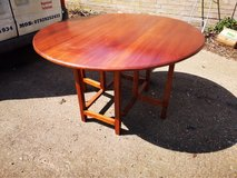 butterfly table. 130cm long x 48cm wide x 75.5cm high (sides down) 130cm diameter when up in Lakenheath, UK