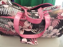 Roxy Pink Flowered Rolling Luggage Bag with handle in Conroe, Texas