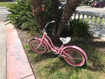 Adorable girls pink and white Electra beach cruiser in Camp Pendleton, California