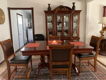 cabinet and table and chairs in Fort Leonard Wood, Missouri