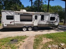 2013 hide outl travel trailer by Keystone 30' with double slidells in Conroe, Texas