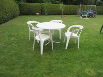 white patio set with 4 stacking chairs + round table in Ramstein, Germany