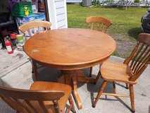 Oak kitchen table with four chairs in Camp Lejeune, North Carolina