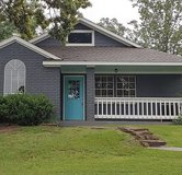 Super adorable water view home. in Coldspring, Texas
