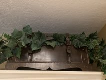 Wood and leather trunk with greenery in Kingwood, Texas
