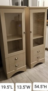 FURNITURE: Two Cabinets. Off White. 2 Drawer w/Glass in Fort Carson, Colorado