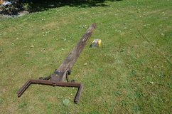 Old village oak signpost very weathered with wrought iron work barn find in Lakenheath, UK