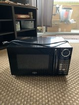 Oster OGB8903 0.9 cu. ft. Digital Microwave Oven - Black in Camp Pendleton, California