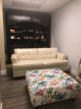Ivory faux leather couch in Fort Benning, Georgia