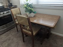 Kitchen table with two chairs and a bench. in Quantico, Virginia