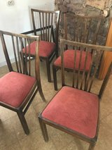 four old red cushion chairs in Jacksonville, Florida