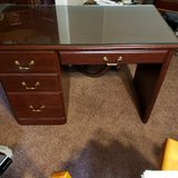 Desk with glass top protector in Warner Robins, Georgia