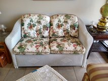 LLOYD FLANDERS Wicker Loveseat with Flowered Cushions in Naperville, Illinois