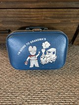 Going to grandmas vintage suitcase for dusplay in Baytown, Texas