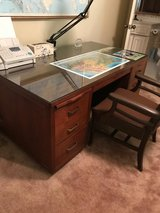 Solid wood desk with glass top in Kingwood, Texas
