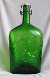 Italian green glass big bottle with French sentence in Okinawa, Japan