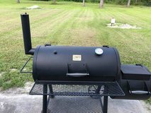 Smoker with Grill Cover . Used. Good Condition in Camp Lejeune, North Carolina