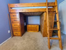 Twin loft bed built-in book shelves, desk and drawers in San Ysidro, California