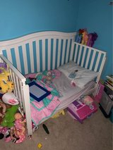 Two (2) Delta Bennington Curved 4 in 1 Cribs and Mattresses in Fort Campbell, Kentucky